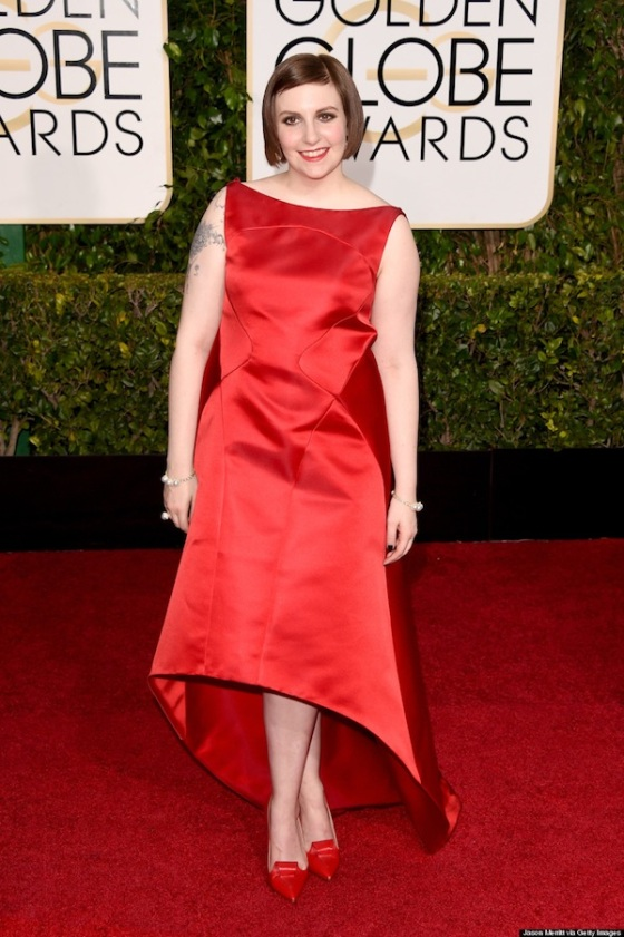 Lena Dunham attends the 72nd Annual Golden Globe Awards in a red dress. Photo: Jason Merritt/Getty Images